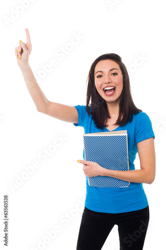 Excited young student raising her hand