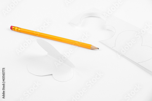 Paper cut out butterfly and pencil, isolated on white