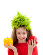 Funny little girl with fresh vegetables