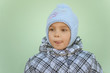 Little girl in warm coat with cap