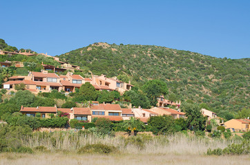 Houses in the green mountain hills.