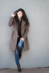 Portrait of a beautiful brunette girl in coat.