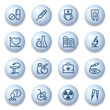 Medicine icons on blue buttons.