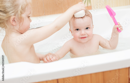 little children bathing