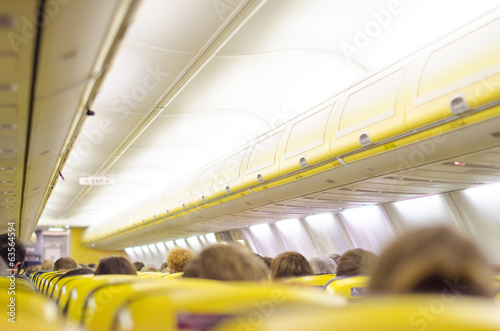 Interior inside of the plane with passengers.
