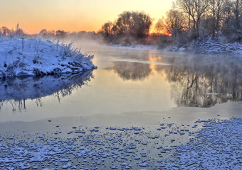 Winter. River. Sunset