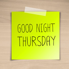 Good night thursday sticky paper on brown wood background textur