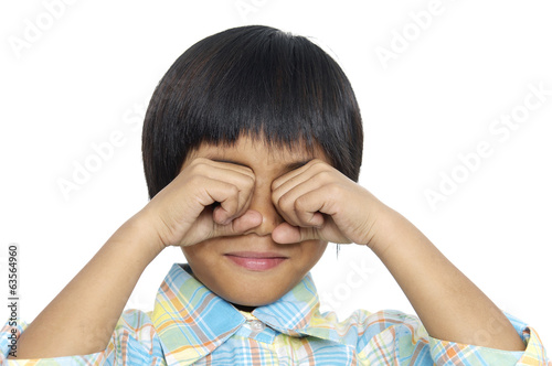 Brunette little girl covering the eyes isolated
