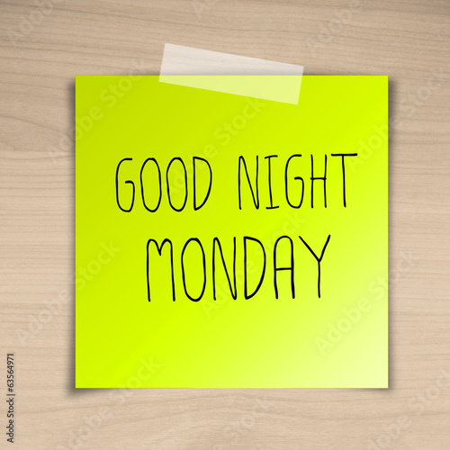 Good night monday sticky paper on brown wood background texture