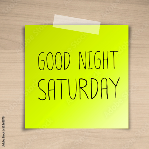 Good night saturday sticky paper on brown wood background textur