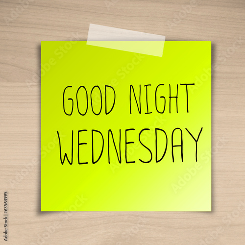 Good night wednesday sticky paper on brown wood background textu