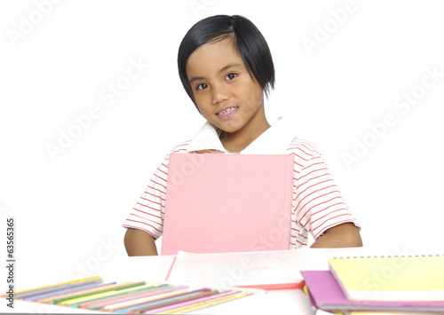Portrait of little schoolgirl smiling ,isolated