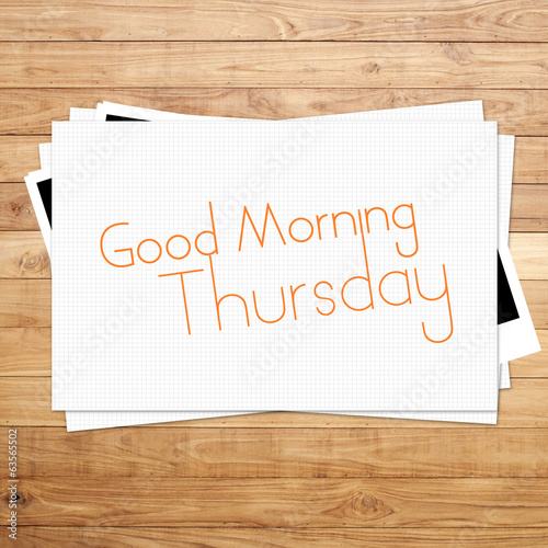 Good Morning Thursday on paper and Brown wood plank background