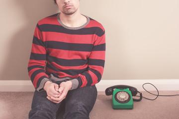 Man on floor with telephone