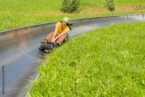 Woman Enjoying Summer Sledge