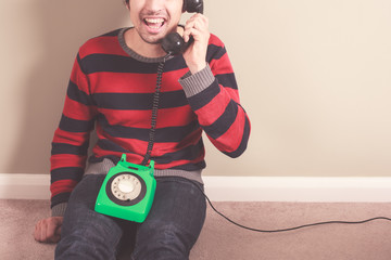 Happy man on the telephone