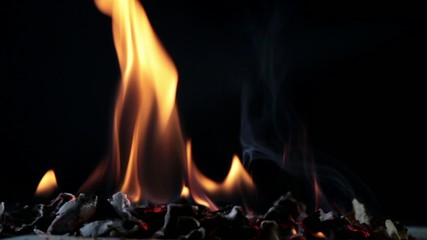 Embers And Flames On The Dark Background.