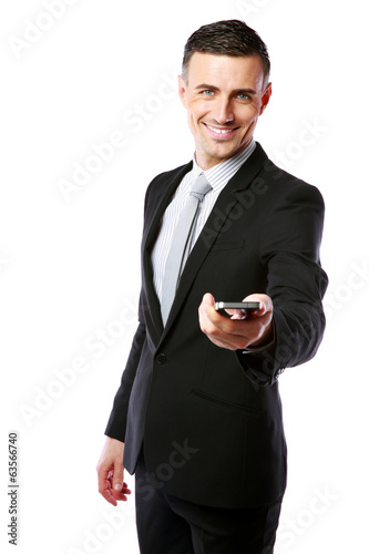 businessman in a suit giving you a smartphone