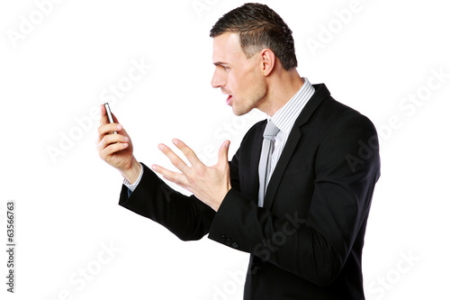 Angry businessman yelling on his cell phone