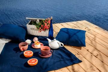 romantic dinner on terrace near the water