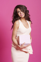 Beautiful elegant woman posing with gift box