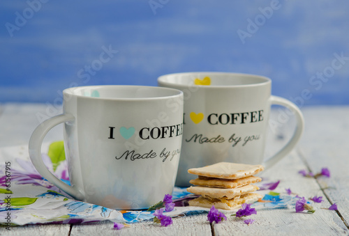 Two cups of coffee with biscuits
