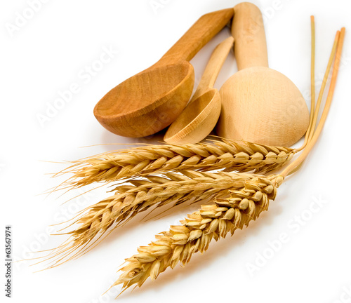 image of a spoon and wheat on white background