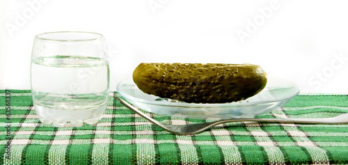 image of glasses with vodka and pickled cucumber on cloths