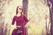 Redhead women  in a park with camera