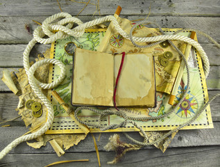 Pirate maps with old book and rope