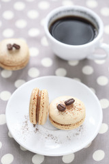 Coffee Macarons with a cup of coffee