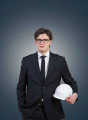 Businessman holding a white hat