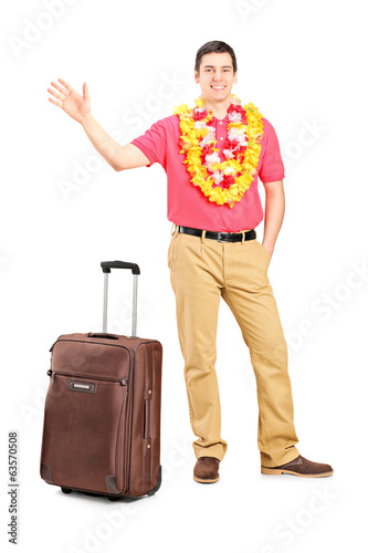 Man, ready for a vacation, waving with hand
