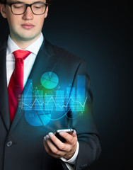 Businessman and phone projection with graphs