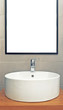 Washbasin in modern bathroom with mirror on the wall