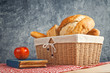 Delicious bread and rolls in wicker basket