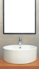 Washbasin in modern bathroom with mirror on the wall