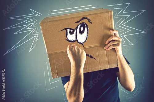 Man with cardboard box on his head and doodle drawing of angry f