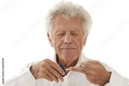 Elderly  diabetic man measuring sugar level in blood