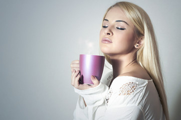 Beautiful woman drinking Coffee. Cup of tea.girl in the Morning