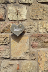 Stone Heart shape with text bonheur french for happiness