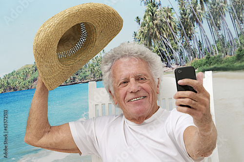 Senior man on vacation taking picture of himself