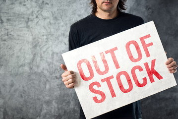 Out of Stock sign in hands of storage employee