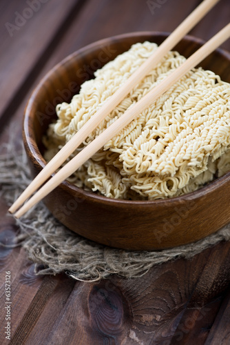 Chinese noodles and eating sticks, vertical shot, close-up