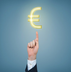 forefinger pointing at the euro sign