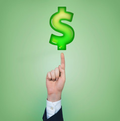 A hand pointing out to the dollar sign. Green background.