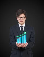 Businessman holding hologram chart