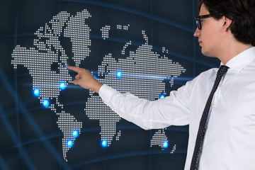 Businessman pointing out the world map
