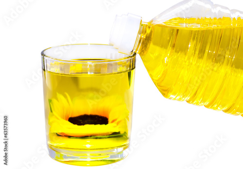 sunflower oil in a bottle and a glass