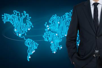 Businessman and a microchip world map